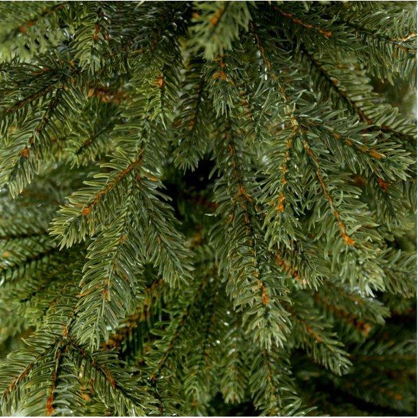 Vánoční stromek - smrk na dřevěném kmeni 220 cm
